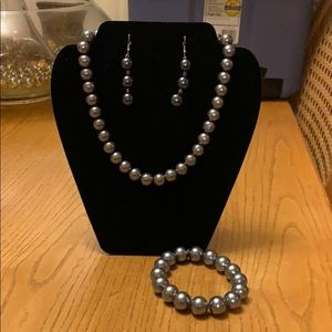 Gray beaded necklace, earrings and bracelet.